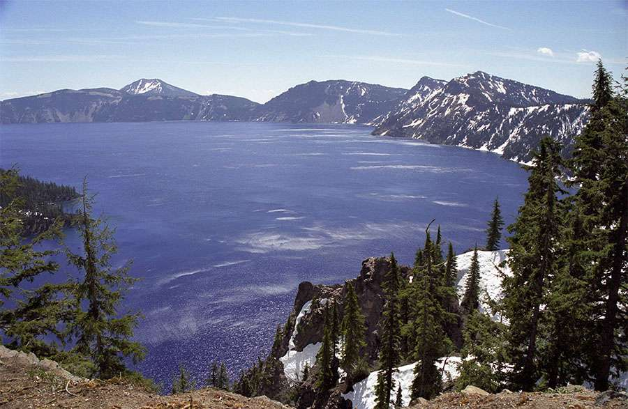 The lake is 1,932 feet at its deepest. The rim averages about 1,500 feet above the lake.