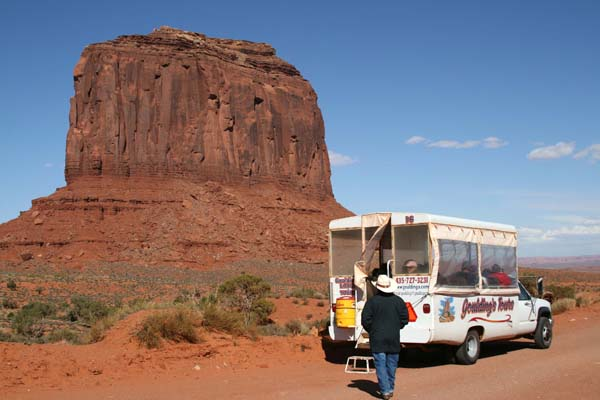 "Our driver, Don, heads fro the ""bus"" with Merrick Rock in the background."