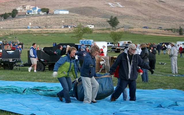 Some teams layout plastic sheeting to keep the balloon off the damp grass.