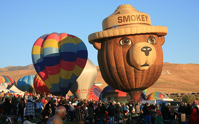 "Smokey Bear was one of the few ""special shape"" balloons in Reno this year. Smokey is piloted by Bill Chapel of Albuquerque, NM. Smokey is jointly sponsored by the US Forest Service, the BLM and the Nevada Forest Service."