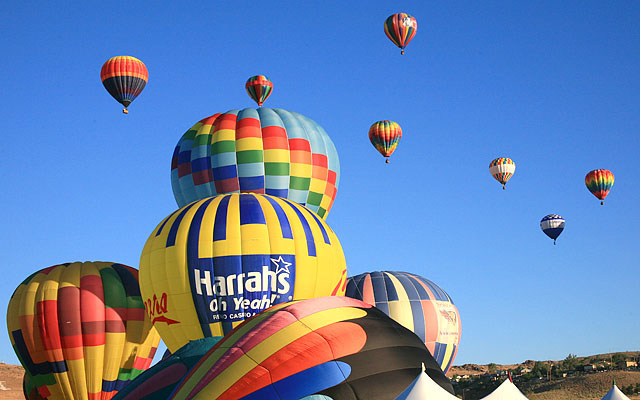 "The yellow and blue balloon is ""Cheers"" piloted by David Wakefield of Sacramento, CA and sponsored by Harrah's Reno."