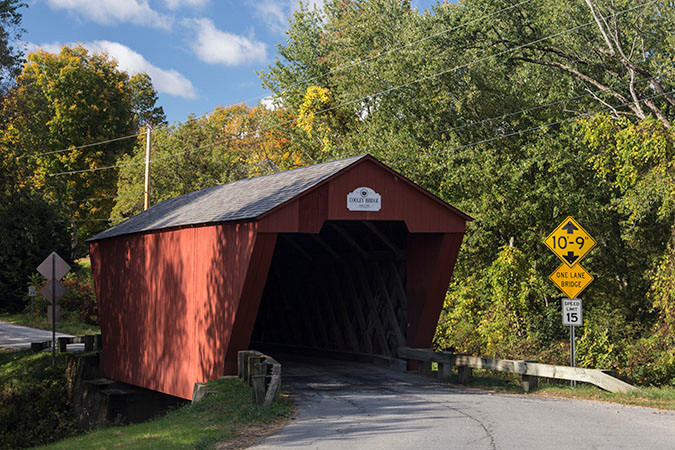 The Cooley Bridge, built in 1849, is a 60 foot Town lattice covered bridge spanning the Furnace Brook on Elm Street in Pittsford, Vermont.