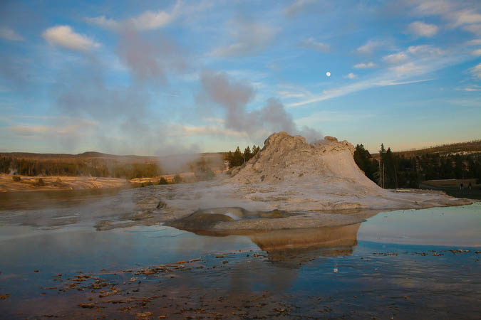 Castle Geyser near sunset with reflected moon
